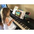 Eve is learning to play the keyboard