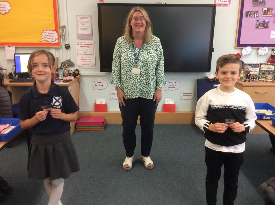 Mrs Allchurch congratulates them and presents them with their special badges.