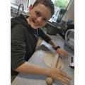 Ewan making chapatis