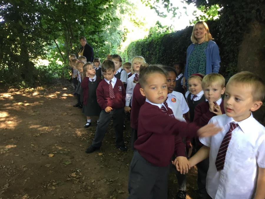 Exploring our woodland area.