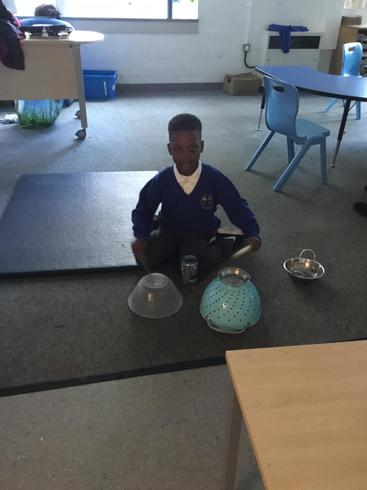 Emmanuel made a drum kit! He can keep the pulse.