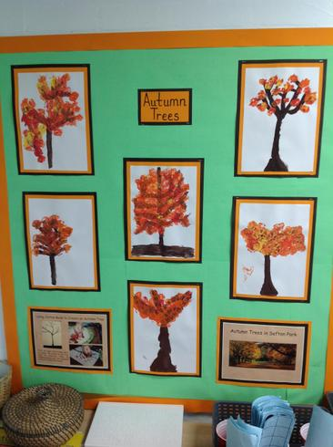 Year 2 used cotton buds to paint autumn leaves.