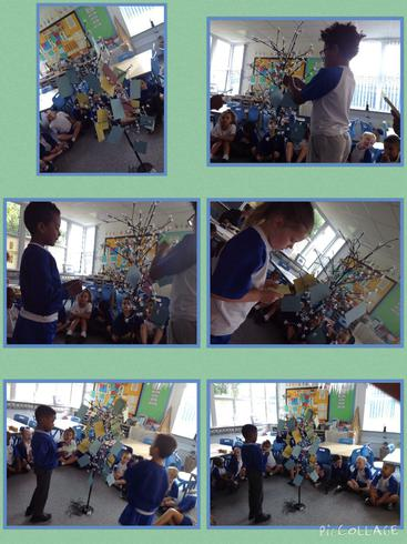 Adding our promise cards to our class tree.
