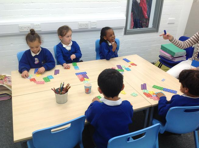 Using numicon to explore the value of numbers.