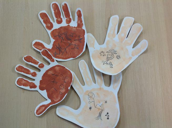 Mehndi designs on our hand prints.
