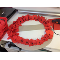 We used the origami poppies to make the wreath