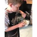 Making white chocolate cookies!