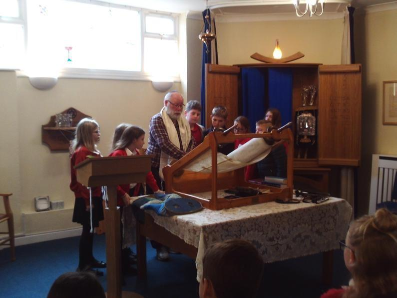 Last week Year 6 were fortunate enough to visit the Bristol and West Jewish Congregation synagogue as part of their Religious Education. They were able to learn about a lot of new information about how Jewish people worship and celebrate throughout the year. Year 6 asked many thoughtful questions and really enjoyed looking at the Torah scrolls during their visit