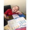 Evie enjoying her maths!