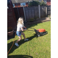 Florence busy mowing the lawn