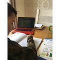 Leo working hard on Maths