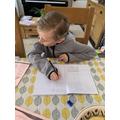 Douglas working hard on Maths