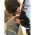 Cian investigates rocks