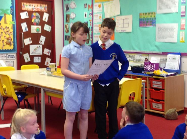 Alex and Evie reading the prayer that they wrote.