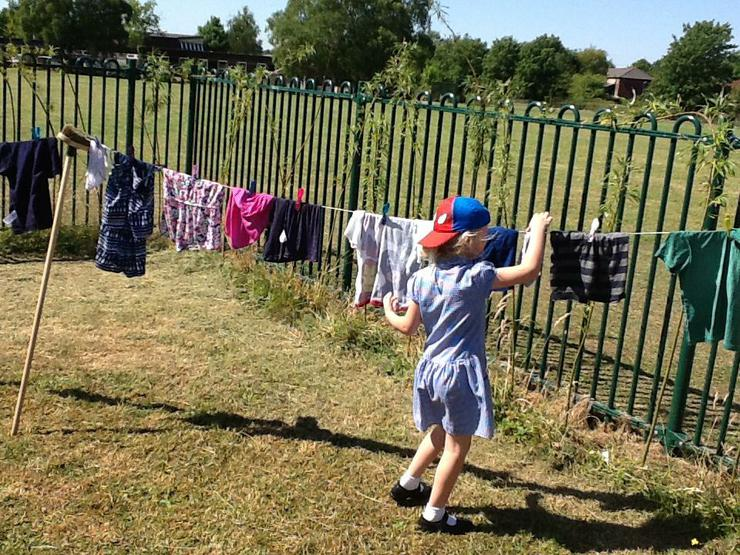 Pegging out our clothes to dry