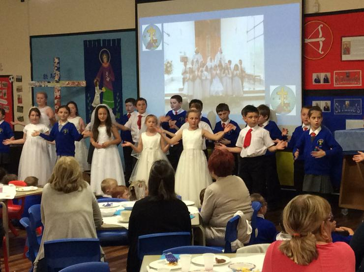 Singing and dancing to 'Can't fight the feeling'.