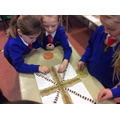 Making a Rangoli pattern using coloured pulses