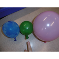 Balloons containing ice, water and air