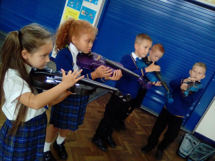 We has some music visitors to learn about different instruments.