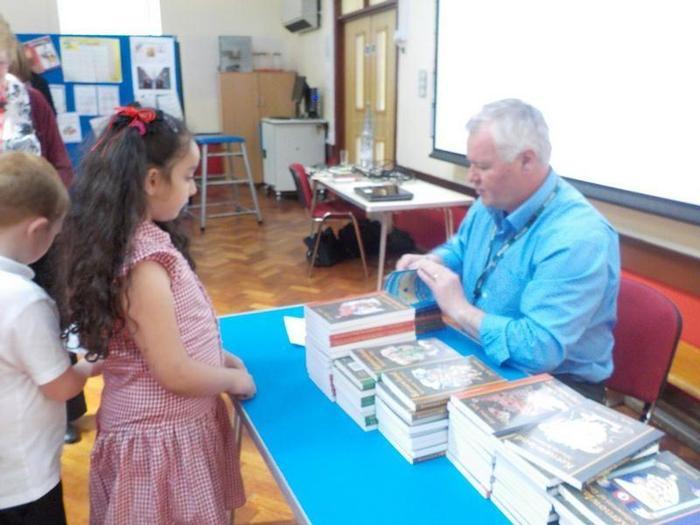Signing Ela's book