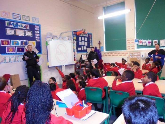 Our local police officers speaking to Year 3 and 4