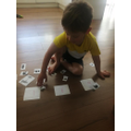 Charlie matching letters.