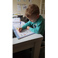 Jamie practicing his letters.