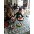 Charlie made pizza with his sister.