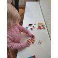 Megan doing a puzzle.