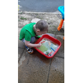 Theo washing his painted cars!