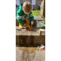 Albie planting seeds.