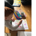 Harry painting his initial.