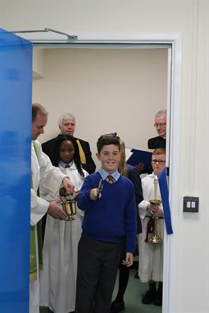 Head Boy cutting the ribbon to St David's Class