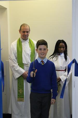 Head Boy cutting ribbon to St Juliana's room