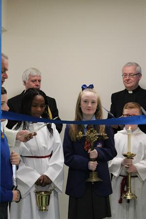 Head Girl cutting the ribbon to St Catherine's