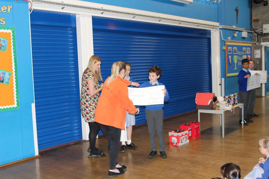 Ellenor Children's Charity receiving the cheque