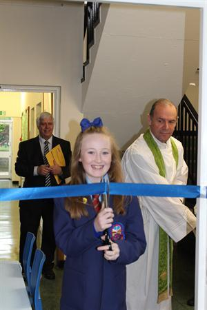 Head Girl cutting ribbon to St Francis Room