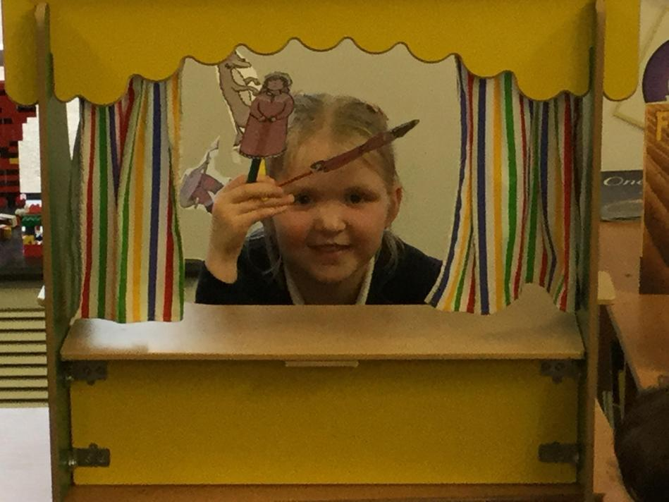 The story of Little Red Riding Hood was retold using puppets for the whole class.