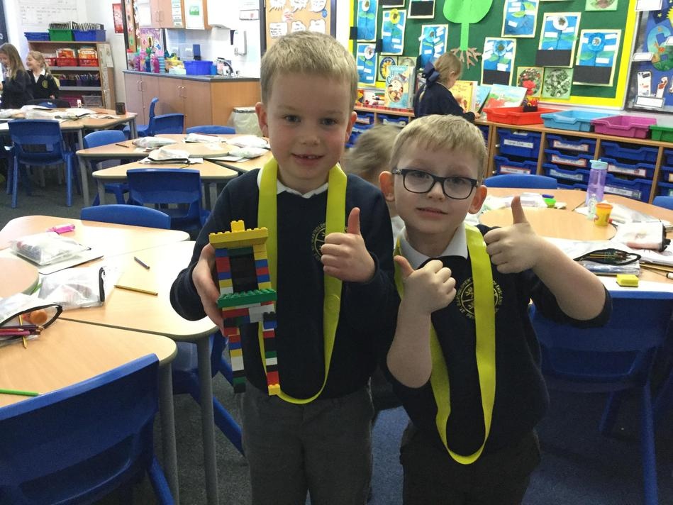 The boys worked together to create a T Rex from lego.