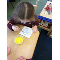 Making Rangoli patterns with sand...