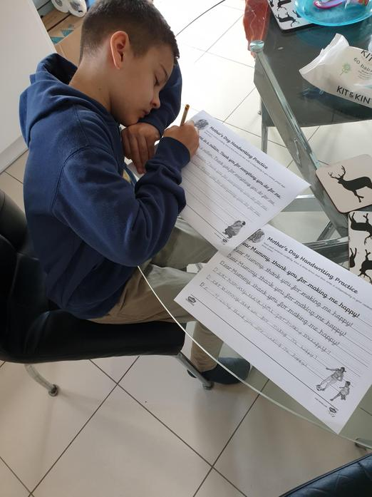 Tristan working really hard on his handwriting.