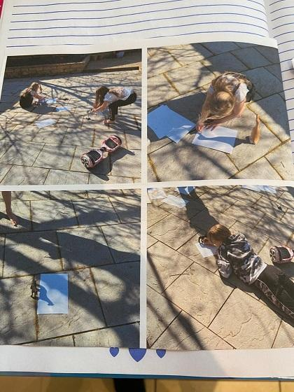 Scarlett and her sisters doing shadow drawings