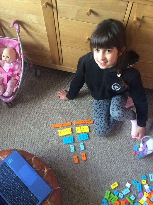 Neve working on equivalent fractions