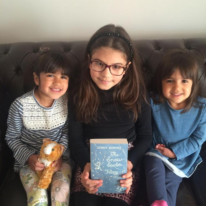 Maya sharing a story with her sisters