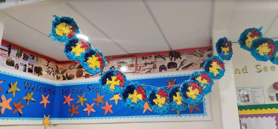 Year 1 had lots of fun making the St. Bernadette's logo with tissue paper