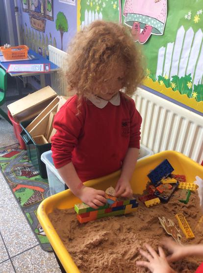 Building a wall for Humpty Dumpty in the sand tray