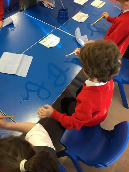 We enjoy writing our letters on the desk!