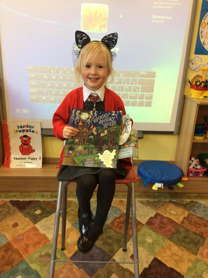 Lucy told us all about her spooky house story book