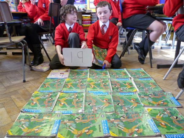 How many text books fit into a square metre?