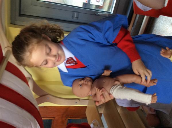Nurse Ruby treating the baby's broken leg